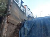 Photo of Muro de telefonia desaba e atinge três casas no bairro de Santa Cruz